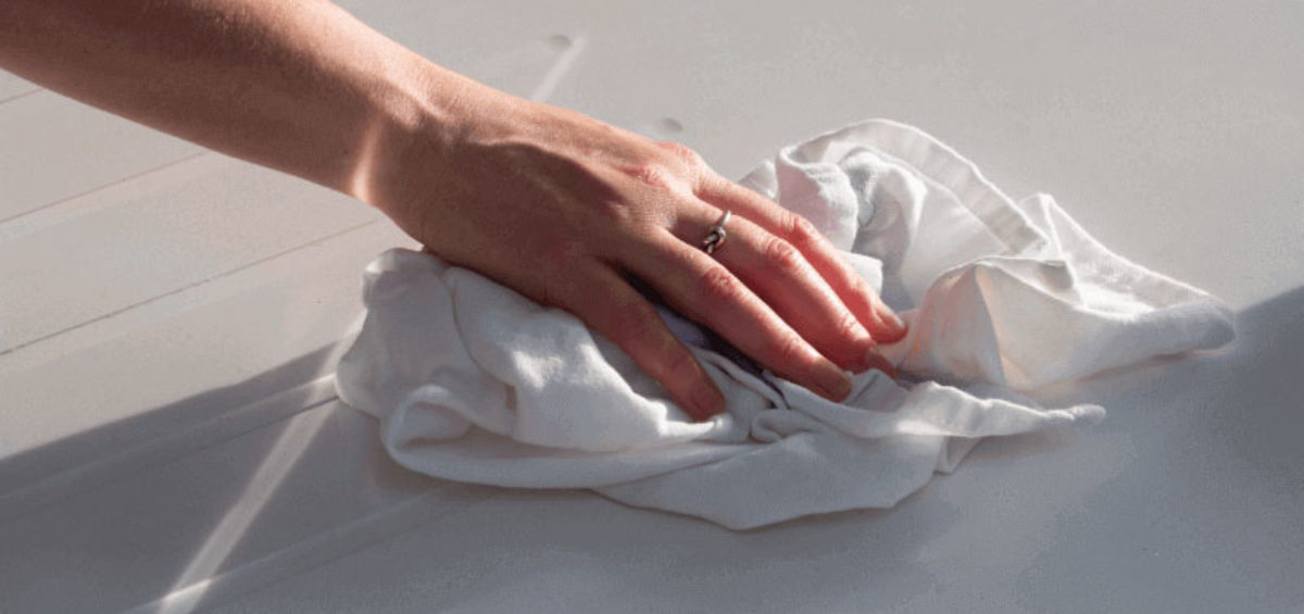 hand-wiping-a-surface-with-a-cloth