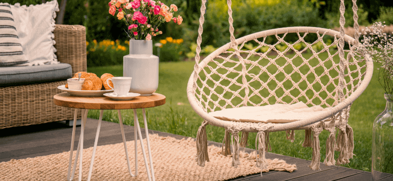 outdoor space with a rug, cushions and comfortable decor