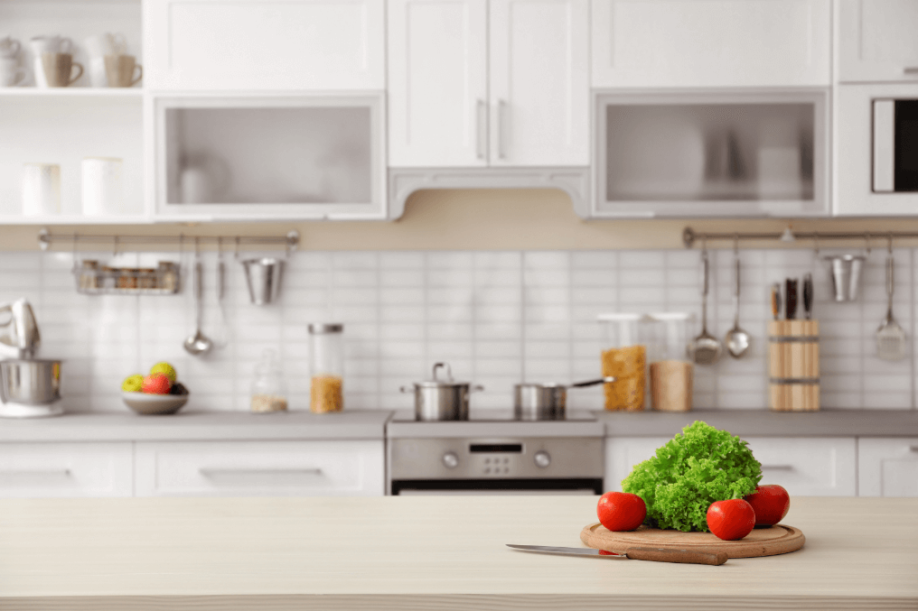 kitchen countertop with chopping board and vegetables