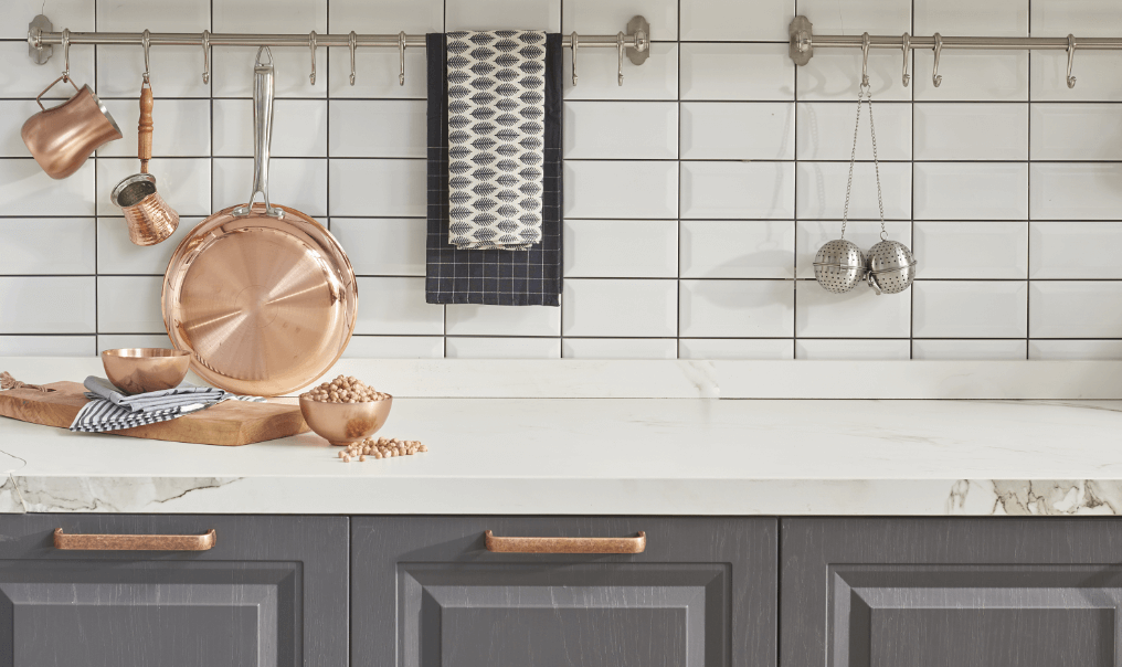 kitchen countertop with pans and teatowels